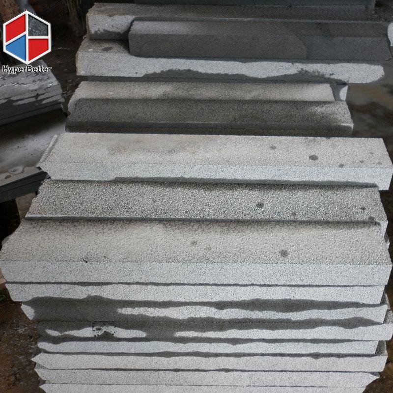 Bush-hammered black basalt cubics (3)
