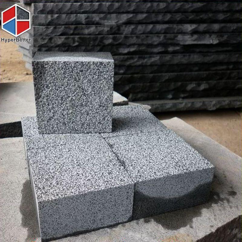 Bush-hammered black basalt cubics
